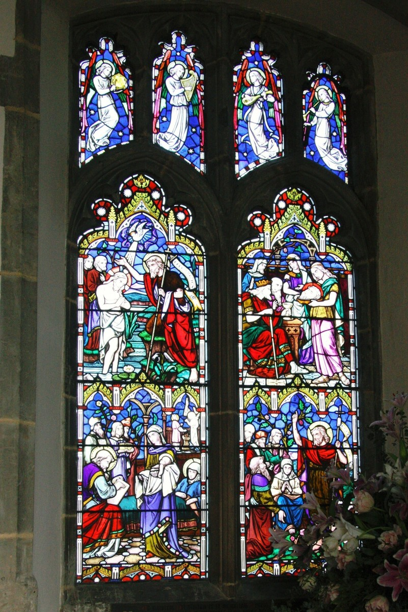 Window shows four scenes from the life and death of St John the Baptist