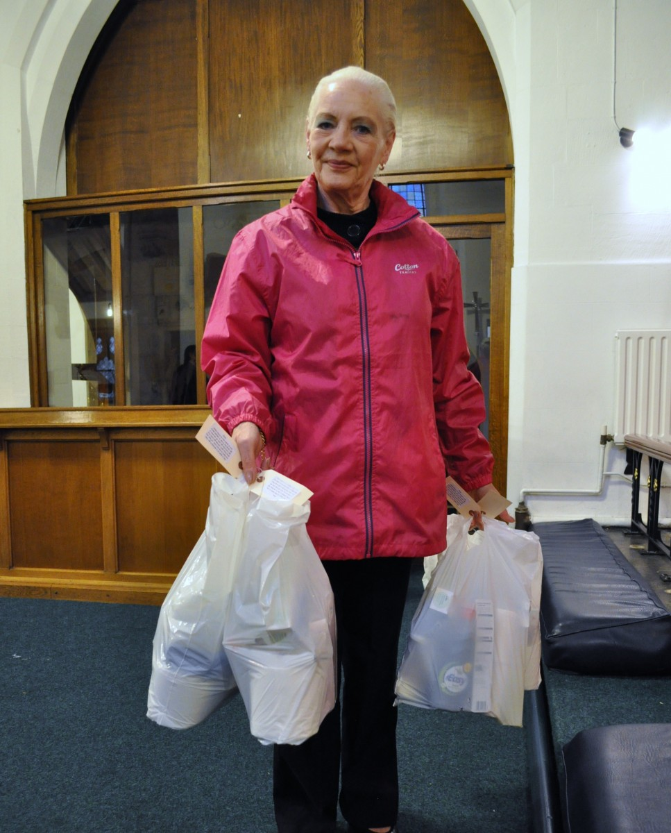 Val carrying food bags