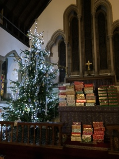 Christmas tree and shoeboxes by the altars