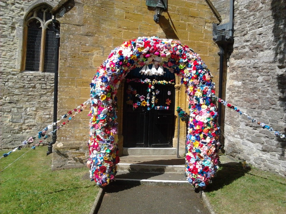 arch of knitted  flowers