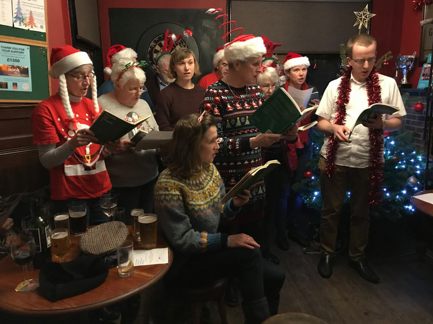 Christ Church choir lead carol singing at The Beehive