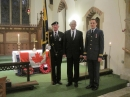 Standard Bearer and Russ Barrie of the British Legion with Capt Paul Bordaush