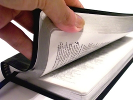 Picture of hand opening Bible