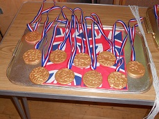 Photo of olympic medals, made by the children at Holiday Club.