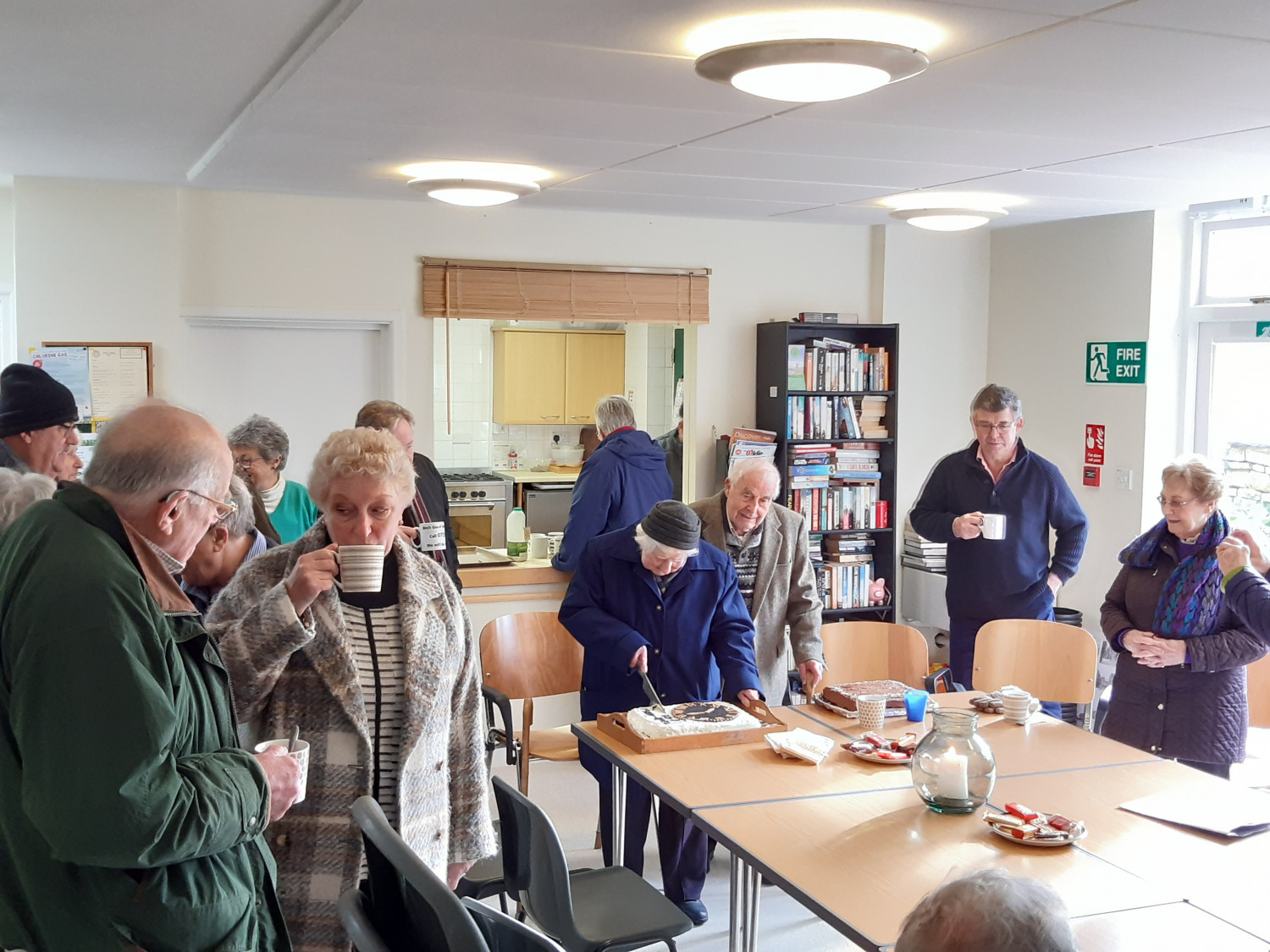 residents enjoy refreshments in village hall