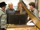 photo of the harpsichord with people admiring