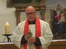 Fr David with the relic of St Andrew