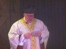 Fr Jason singing at the end of Mass
