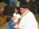 Fr Jason and children at the end of Mass