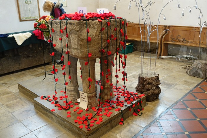 Poignant display of knitted poppies.