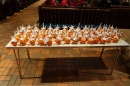 Hundreds of Christingles await their turn to be presented to the children.