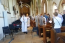 Bishop Jonathan 'processes' Ralph around St. Nicholas Church after his baptism.