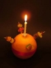 'Close-up' of a Christingle, showing the elements of the Christingle.