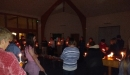 Prayer and singing with the Christingles lit