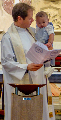 Derek performing a baptism