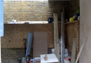 Starting work on the new toilets in the west porch, opposite the office