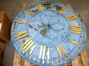 A clock face in the workshop