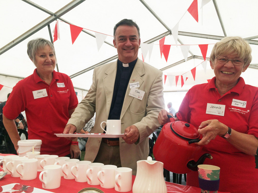 Photo showing 3 people smiling and serving drinks. One is the Minister of Ashbourne Methodist Church and Circuit