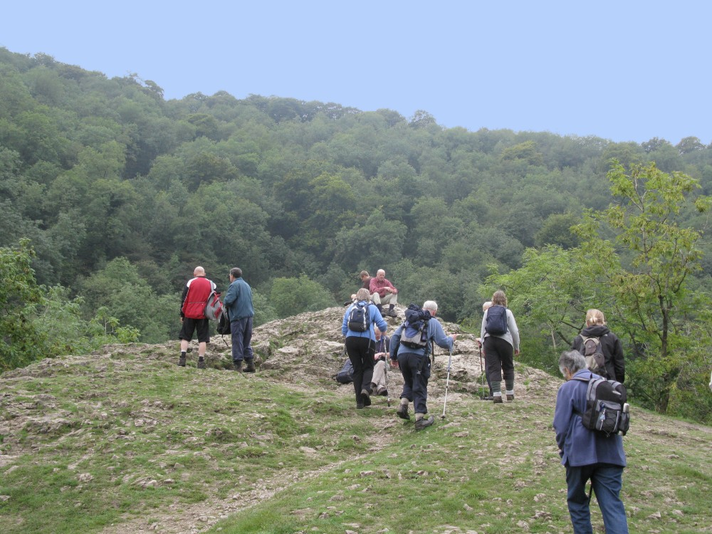 A photo of walkers at the top of a hill