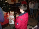Children receiving christingles