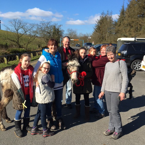 Gathering with donkeys on Palm Sunday