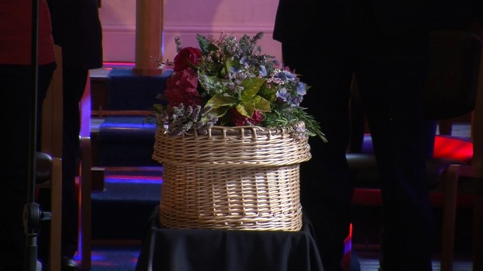 The wicker casket holding the remains to be reburied