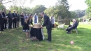 Anwen Caffell and John Buglass with the wicker casket in the churchyard