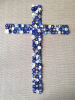 Cross made of hand crafted forget-me-nots