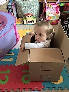 Marian's grand daughter playing in a box