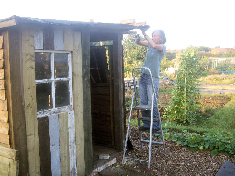 Emma building her shed