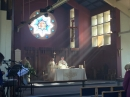The sun shining on the altar during the Eucharistic Prayer.