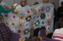 A beautiful hand-made quilt being raffled