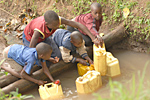 Picture of children in Africa getting water from a river