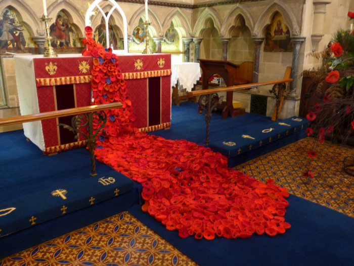 Cascade of poppies knitted by ladies of the parish