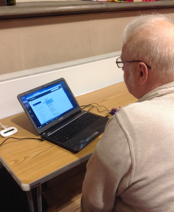 image of man sat in front of a laptop computer