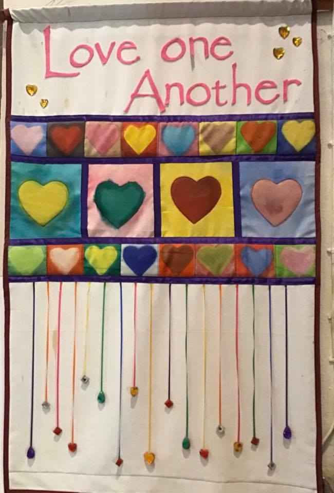 image of banner saying love one another