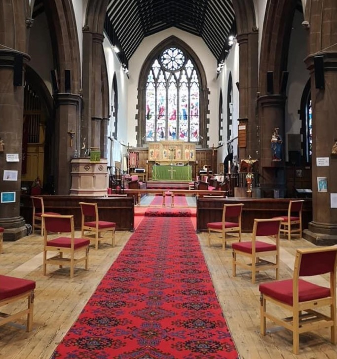 image of inside church with chairs spaced apart for social distancing