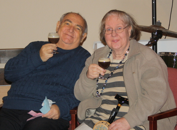 image of two people enjoying a drink