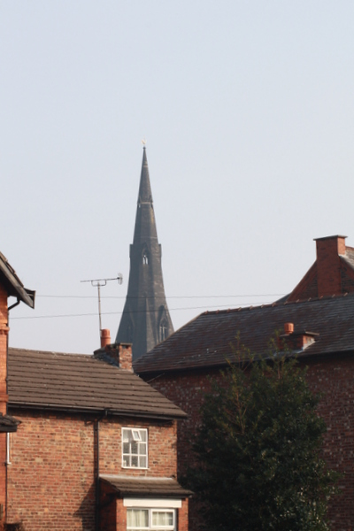 image of house with St Matthews church spiire in the distance