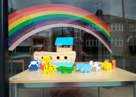 Window display with Noah's ark and large rainbow