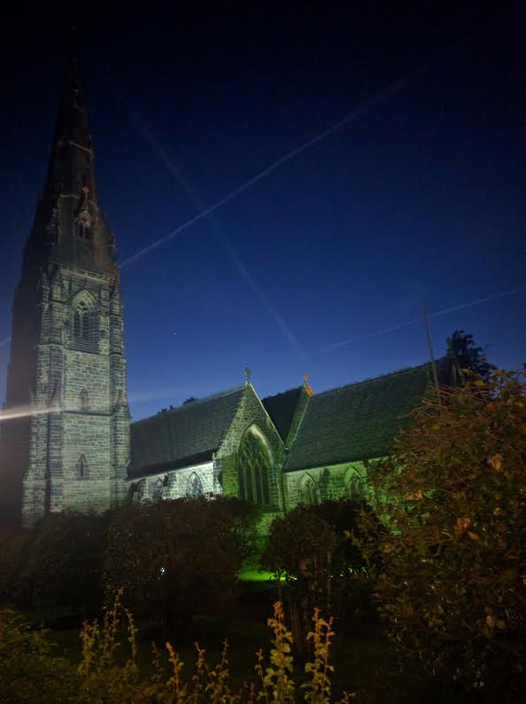 The church illuminated at night