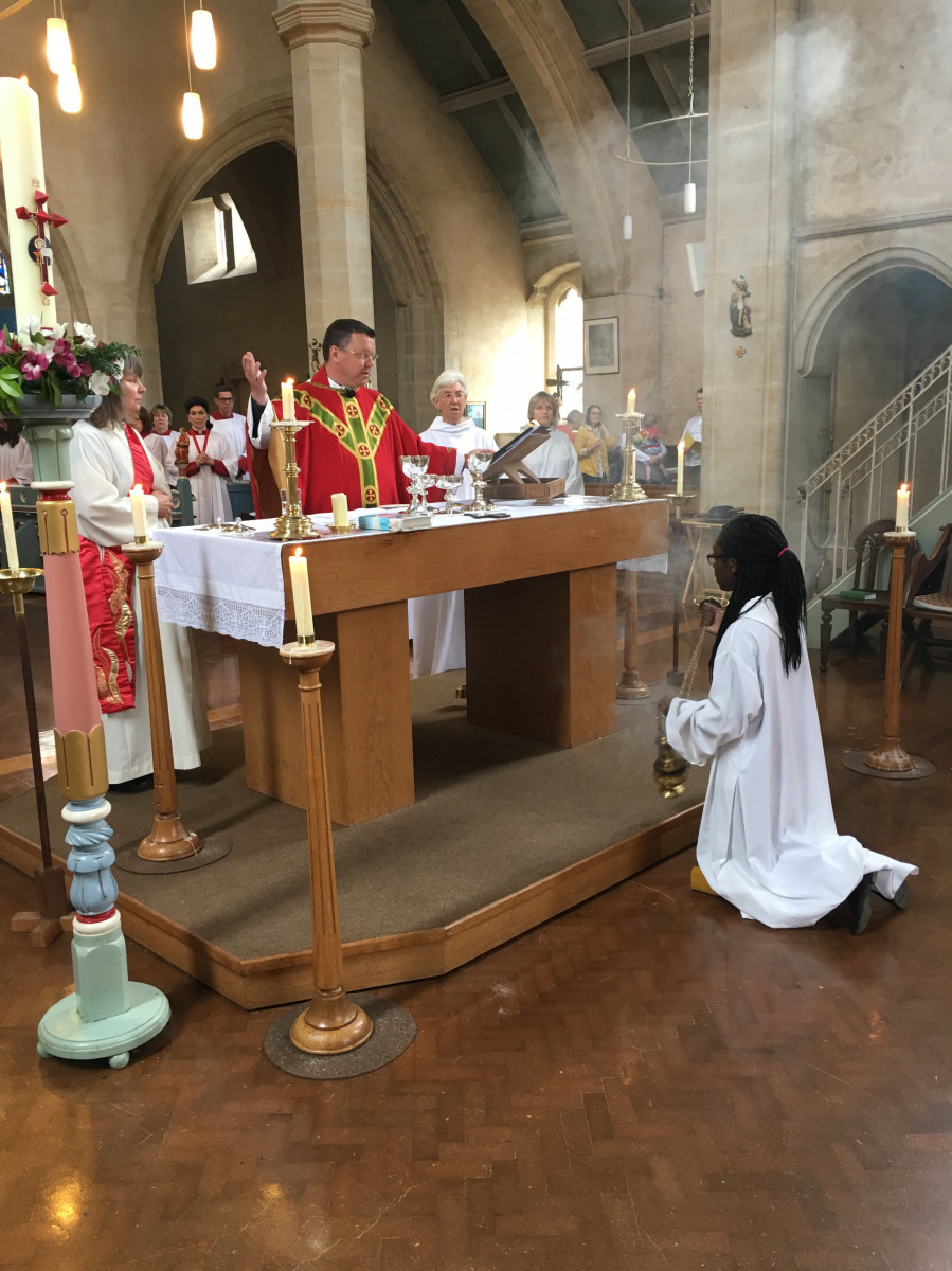 Priest prays the prayer of consecration at the altar