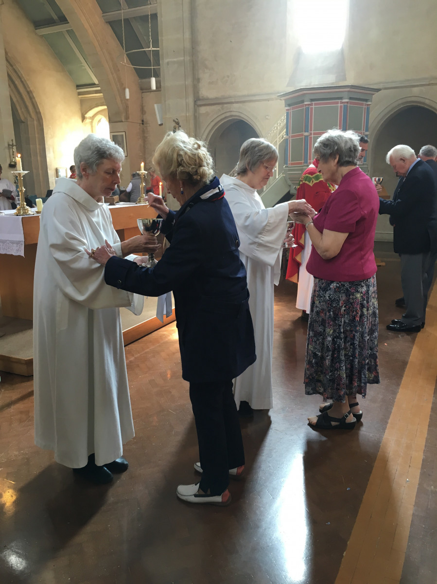 Members of congregation receive Holy Communion