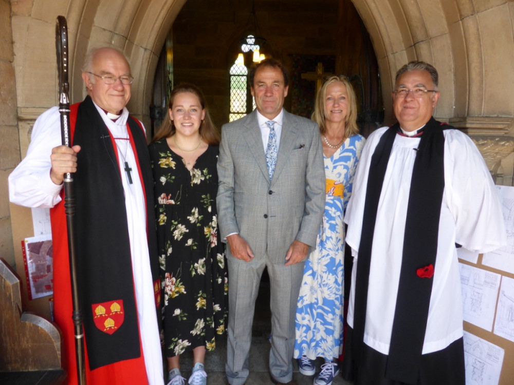 Bishop Peter, Revd Peter Mackriell, Mr Charles Tomkinson (great great grandson of the church's benefactor), with his wife and daughter.