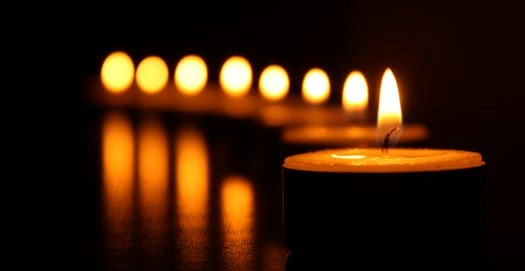 lighted votive tealight candles in the dark