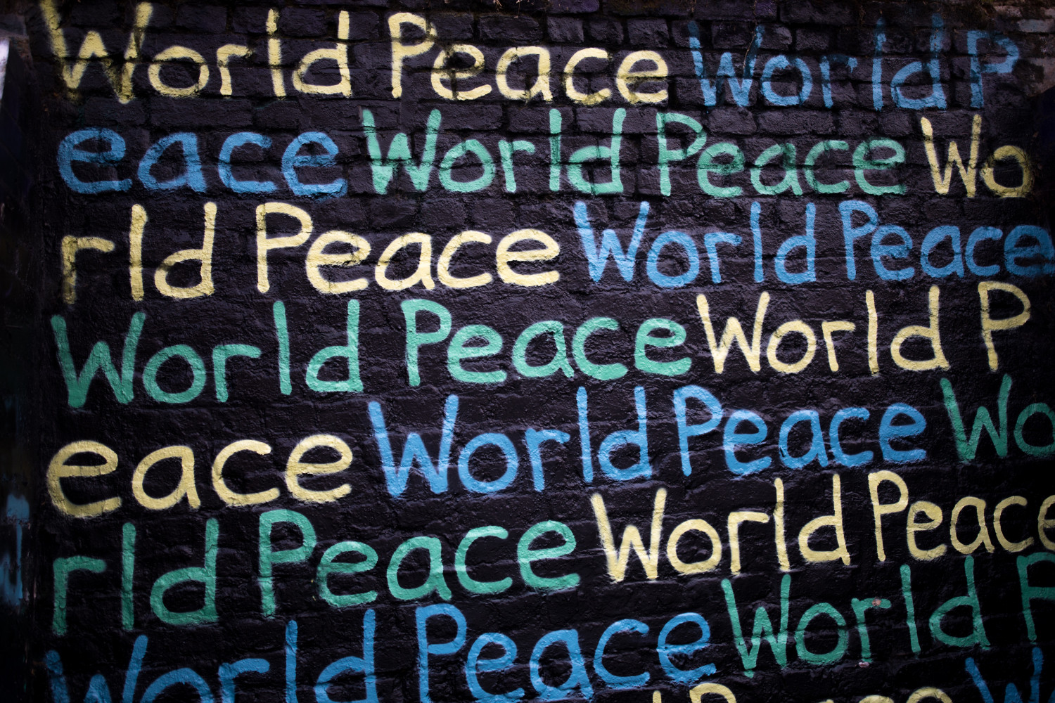 Wall with 'world peace' written in a repeating pattern