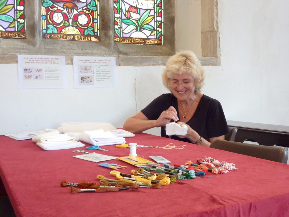 Ruth embroidering a silk card