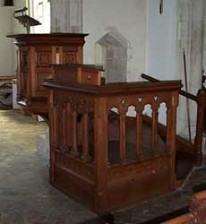 Double pulpit and opening in arch to north aisle