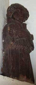 Wooden carving on left