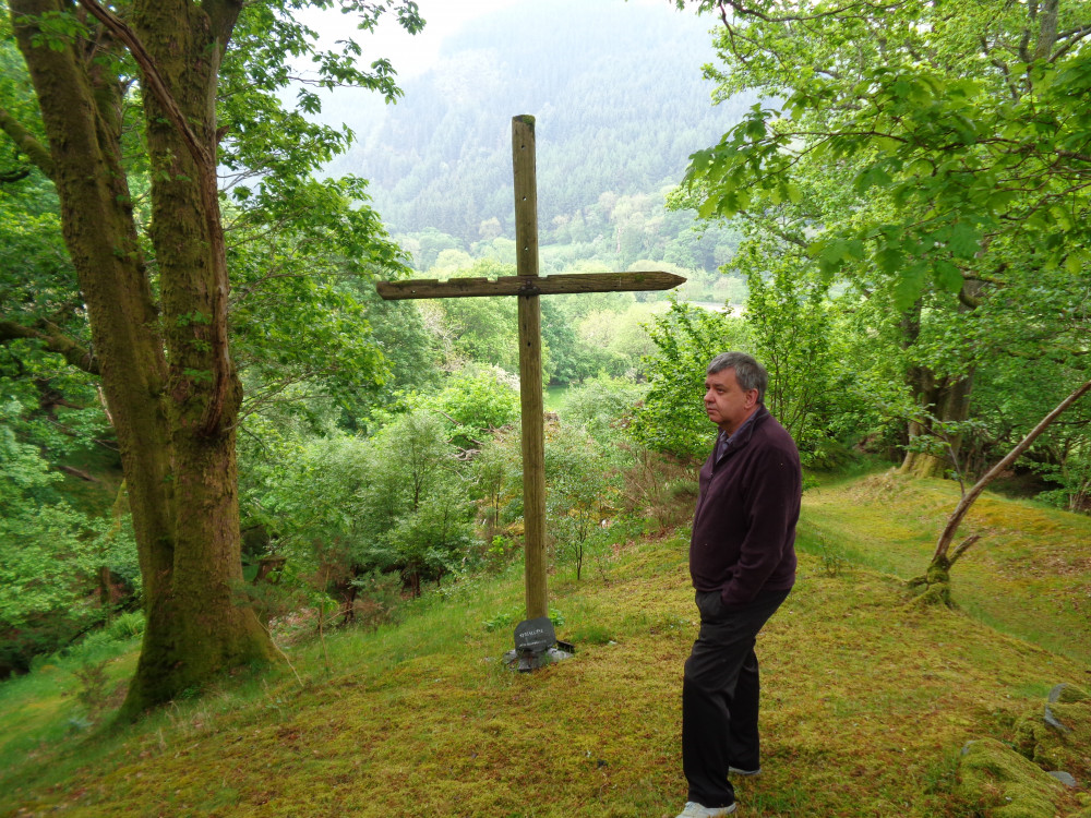Photo of Mike next to a cross